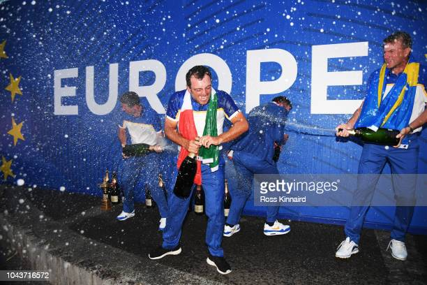 Francesco Molinari of Europe sprays Champagne as he celebrates after winning The Ryder Cup following the singles matches of the 2018 Ryder Cup at Le...