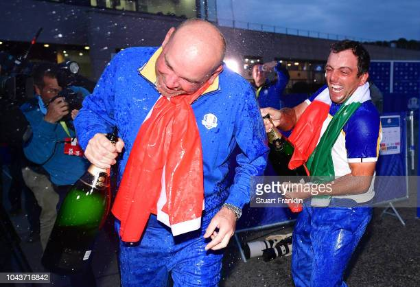 Francesco Molinari of Europe sprays champagne over Captain Thomas Bjorn of Europe after they win The Ryder Cup following singles matches of the 2018...