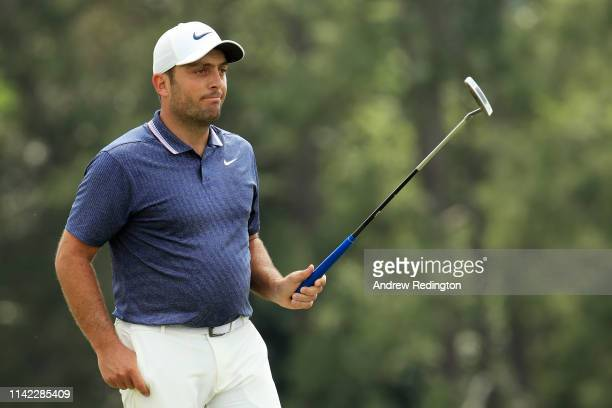 Francesco Molinari of Italy acknowledges patrons on the 18th green during the second round of the Masters at Augusta National Golf Club on April 12...