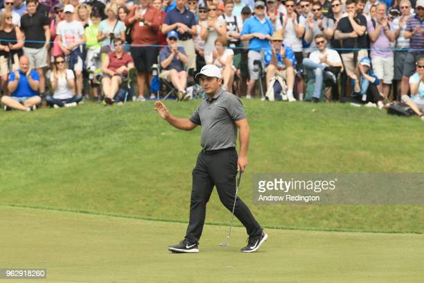 Francesco Molinari of Italy acknowledges the crowd after a birdie on the 3rd green during day four and the final round of the BMW PGA Championship at...