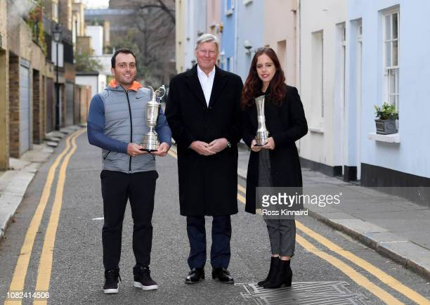 Francesco Molinari of Italy and Georgia Hall of England pose with their British Open trophies along with Martin Slumbers, Chief Executive of The R&A...