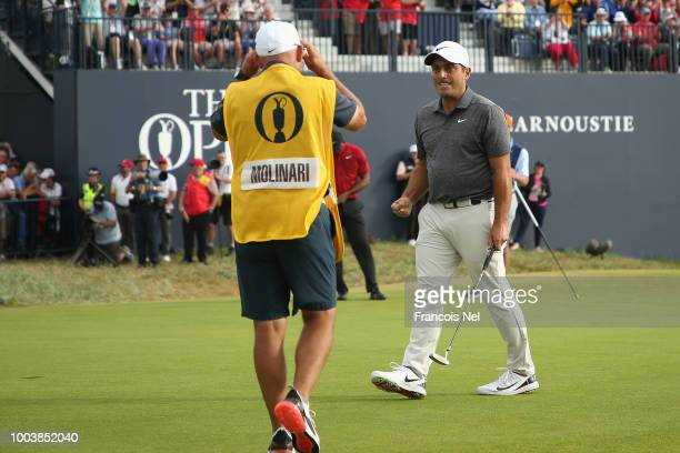 Francesco Molinari of Italy celebrates a birdie on the 18th hole during the final round of the 147th Open Championship at Carnoustie Golf Club on...