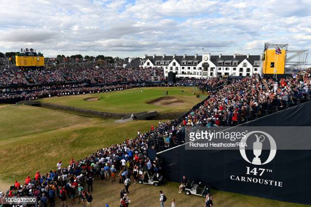 Francesco Molinari of Italy celebrates his birdie on the 18th green during the final round of the Open Championship at Carnoustie Golf Club on July...