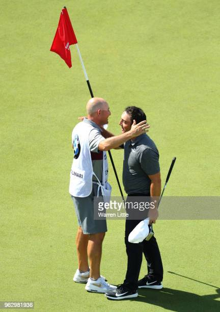 Francesco Molinari of Italy celebrates victory on the 18th green with his caddie during day four and the final round of the BMW PGA Championship at...