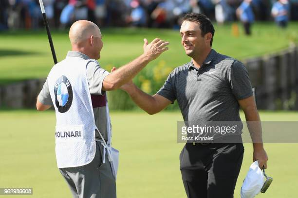 Francesco Molinari of Italy celebrates victory with his caddie on the 18th green during the final round of the BMW PGA Championship at Wentworth on...
