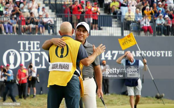 Francesco Molinari of Italy celebrates with his caddie Pello Iguaran after a birdie on the 18th hole during the final round of the 147th Open...