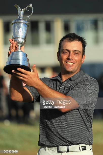 Francesco Molinari of Italy celebrates with the Claret Jug after winning the 147th Open Championship at Carnoustie Golf Club on July 22 2018 in...