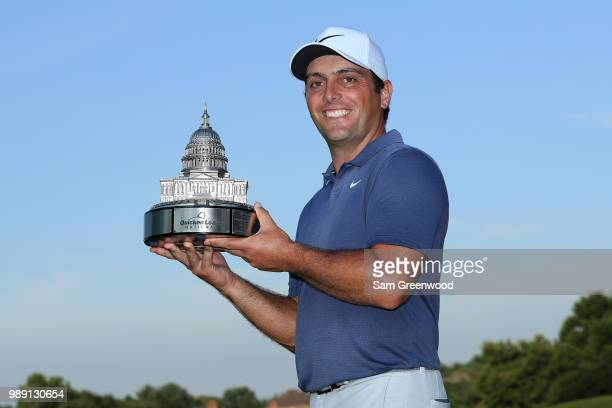 Francesco Molinari of Italy celebrates with the trophy after winning the Quicken Loans National during the final round at TPC Potomac on July 1 2018...