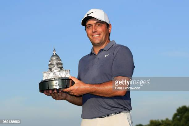 Francesco Molinari of Italy celebrates with the trophy after winning the Quicken Loans National during the final round at TPC Potomac on July 1, 2018...