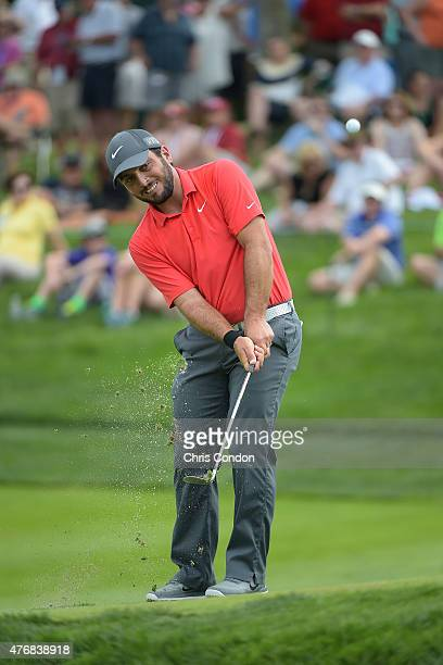 Francesco Molinari of Italy chips to the 10th green during the final round of the Memorial Tournament presented by Nationwide at Muirfield Village...