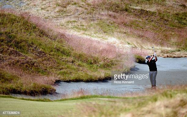 Francesco Molinari of Italy hits a shot from a bunker during a practice round prior to the start of the 115th U.S. Open Championship at Chambers Bay...