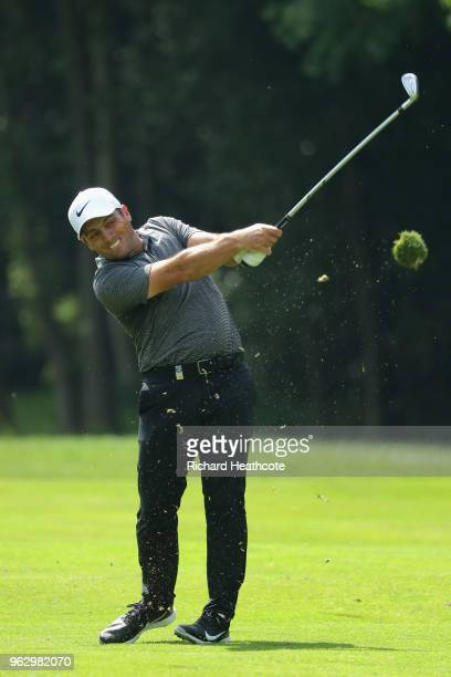 Francesco Molinari of Italy hits his second shot on the 16th hole during the final round of the BMW PGA Championship at Wentworth on May 27 2018 in...