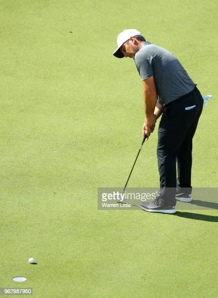 Francesco Molinari of Italy hits the winning putt on the 18th green during day four and the final round of the BMW PGA Championship at Wentworth on...