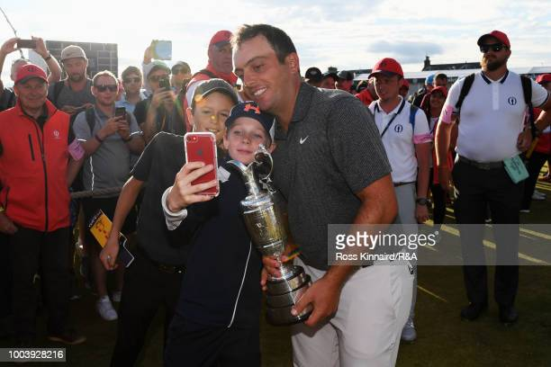 Francesco Molinari of Italy holds the Claret Jug as Champion Golfer and poses for a selfie with young golf fans after winning the 147th Open...