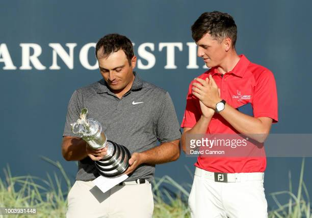 Francesco Molinari of Italy holds The Claret Jug as Champion Golfer of the Year as Sam Locke of Scotland the wninner of the Silver Medal for leading...