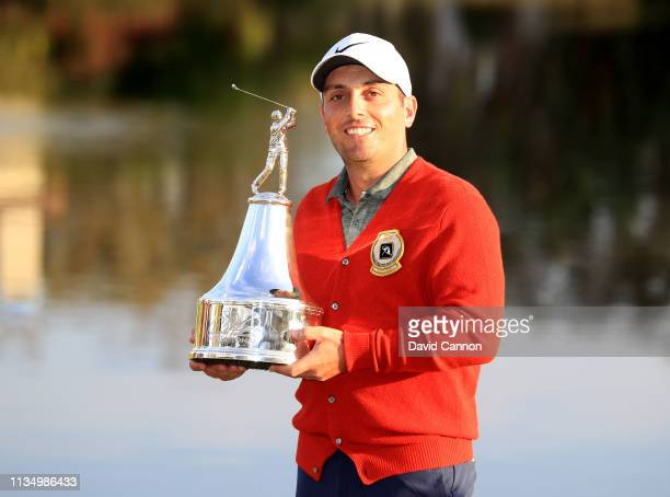 Francesco Molinari of Italy holds the trophy after his three shot win in the final round of the 2019 Arnold Palmer Invitational at the Arnold Palmer...