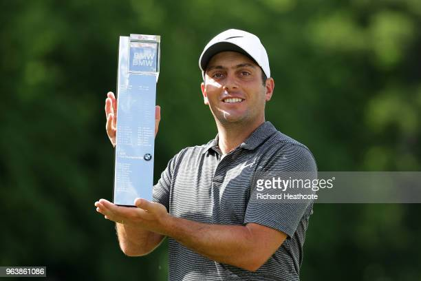 Francesco Molinari of Italy holds the trophy after victory in the final round of the BMW PGA Championship at Wentworth on May 27 2018 in Virginia...