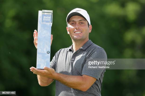Francesco Molinari of Italy holds the trophy after winning the BMW PGA Championship at Wentworth on May 27, 2018 in Virginia Water, England.
