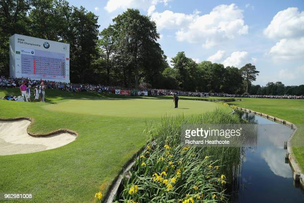 Francesco Molinari of Italy holes out on the 18th green to win during the final round of the BMW PGA Championship at Wentworth on May 27, 2018 in...