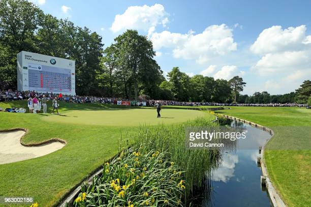 Francesco Molinari of Italy holes the winning putt on the par 5, 18th hole during the final round of the 2018 BMW PGA Championship on the West Course...