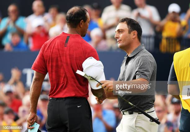 Francesco Molinari of Italy is congratulated by Tiger Woods of the United States after a birdie on the 18th hole during the final round of the 147th...
