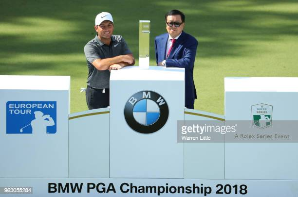 Francesco Molinari of Italy is presented with the trophy after victory on day four and the final round of the BMW PGA Championship at Wentworth on...