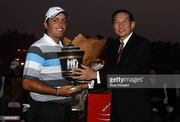 Francesco Molinari of Italy is presented with the winners trophy by Peter Wong the CEO HSBC AsiaPacfic after the final round of the WGC HSBC...