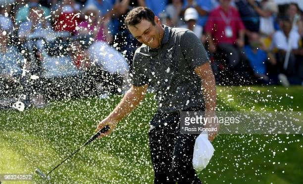 Francesco Molinari of Italy is sprayed with champagne after victory in the final round of the BMW PGA Championship at Wentworth on May 27 2018 in...