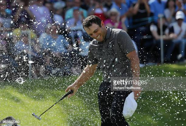 Francesco Molinari of Italy is sprayed with champagne after victory in the final round of the BMW PGA Championship at Wentworth on May 27, 2018 in...
