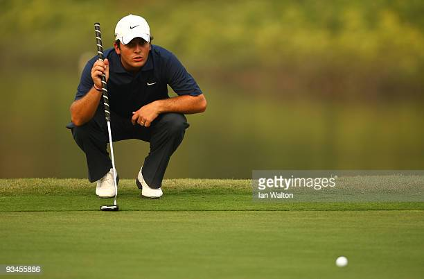 Francesco Molinari of Italy lines up a put during the Fourballs on the 3rd day of the Omega Mission Hills World Cup on the Olazabal course on...