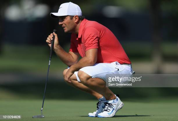 Francesco Molinari of Italy lines up a putt during a practice round prior to the 2018 PGA Championship at Bellerive Country Club on August 8 2018 in...
