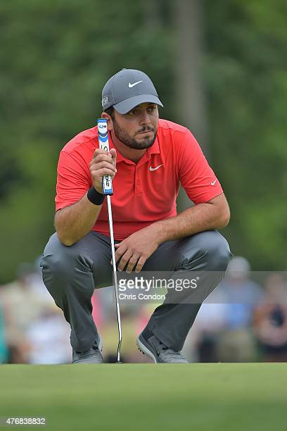 Francesco Molinari of Italy lines up a putt on the 9th green during the final round of the Memorial Tournament presented by Nationwide at Muirfield...