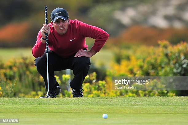 Francesco Molinari of Italy lines up his putt on the 16th hole during the final round of The Estoril Open de Portugal The Oitavos Dunes Golf Course...