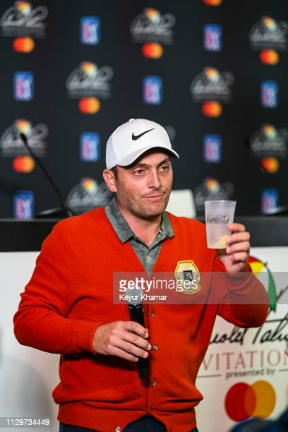 Francesco Molinari of Italy makes a toast to Arnold Palmer during a press conference following his two stroke victory in the final round of the...
