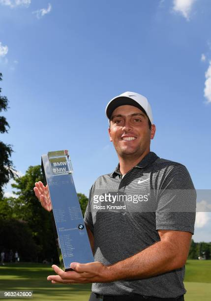Francesco Molinari of Italy pictured with the winners trophy on the 18th green after the final round of the BMW PGA Championship at Wentworth on May...