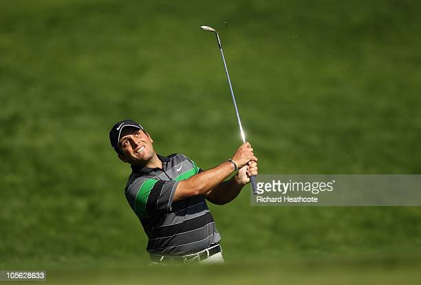 Francesco Molinari of Italy pitches onto the 15th green during the final round of the Portugal Masters at the Oceanico Victoria Golf Course on...