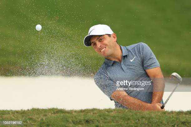 Francesco Molinari of Italy plays a shot from a bunker on the 15th hole during the first round of the WGC HSBC Champions at Sheshan International...