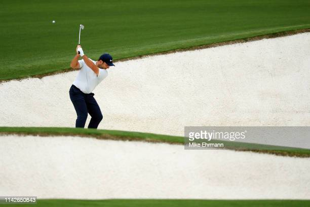 Francesco Molinari of Italy plays a shot from a bunker on the eighth hole during the final round of the Masters at Augusta National Golf Club on...
