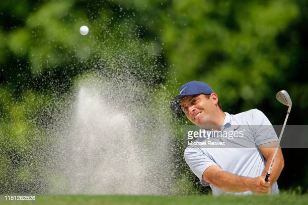 Francesco Molinari of Italy plays a shot from a bunker on the eighth hole during the first round of the Charles Schwab Challenge at Colonial Country...