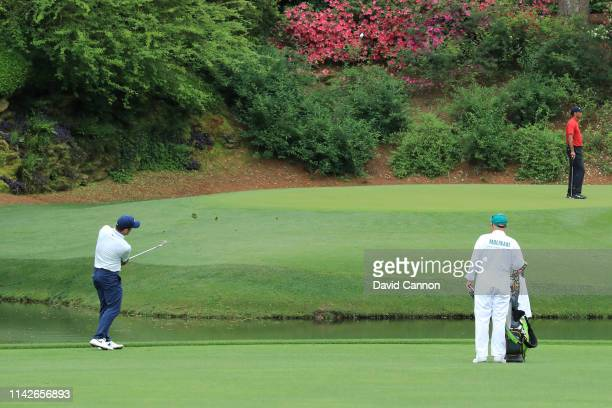 Francesco Molinari of Italy plays a third shot on the 12th hole during the final round of the Masters at Augusta National Golf Club on April 14 2019...