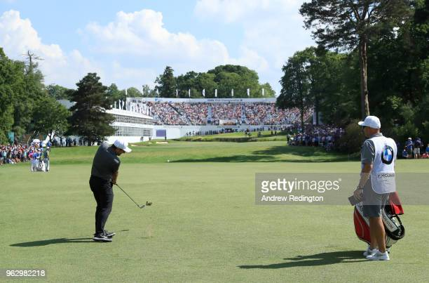 Francesco Molinari of Italy plays an approach to the 18th green during day four and the final round of the BMW PGA Championship at Wentworth on May...