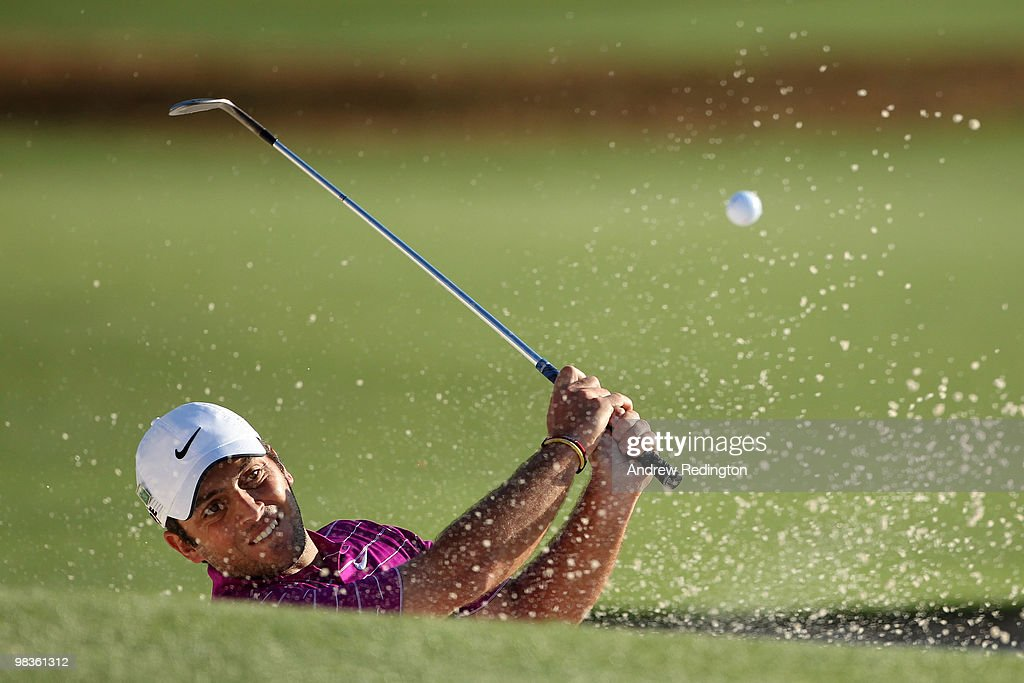 Francesco Molinari of Italy plays from a bunker on the 18th hole during the second round of the 2010 Masters Tournament at Augusta National Golf Club on April 9, 2010 in Augusta, Georgia.