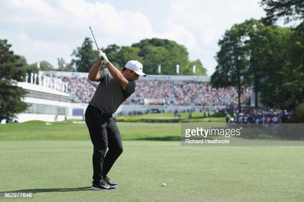 Francesco Molinari of Italy plays his second shot on the 18th hole during the final round of the BMW PGA Championship at Wentworth on May 27, 2018 in...