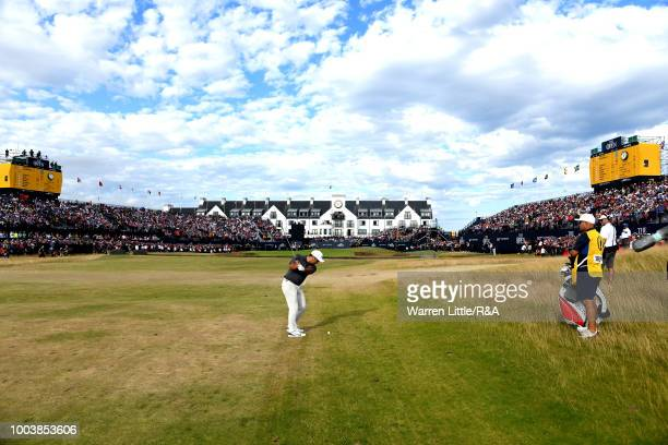 Francesco Molinari of Italy plays his second shot to the 18th green during the final round of the Open Championship at Carnoustie Golf Club on July...