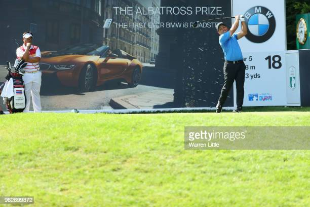 Francesco Molinari of Italy plays his tee shot on the 18th hole during the third round of the BMW PGA Championship at Wentworth on May 26, 2018 in...