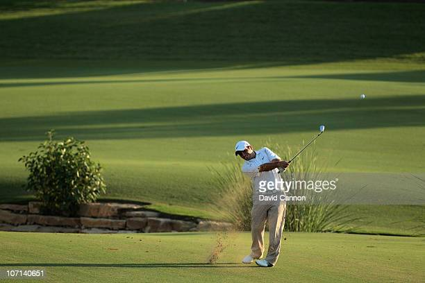 Francesco Molinari of Italy plays his third shot at the 18th hole during the first round of the Dubai World Championship on the Earth Course at...