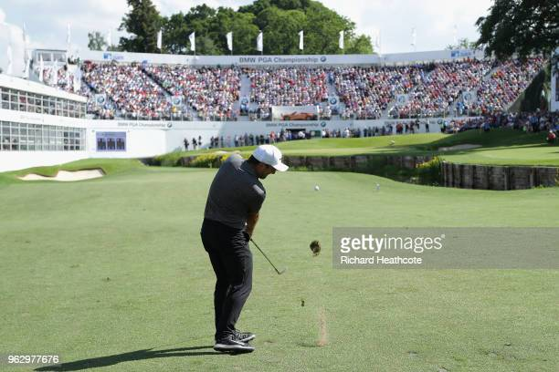 Francesco Molinari of Italy plays his third shot on the 18th hole during the final round of the BMW PGA Championship at Wentworth on May 27 2018 in...