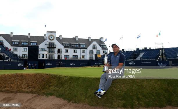Francesco Molinari of Italy pictured with a group of green keepers who had just finnished playing the links course after his victory in the 147th...