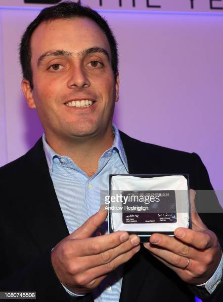 Francesco Molinari of Italy poses with the membership card as he is awarded honorary life membership of the European Tour at the European Tour Golfer...