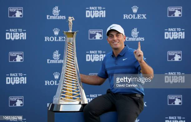 Francesco Molinari of Italy poses with the Race to Dubai trophy as the number one player in Europe in the 2018 season after the final round of the DP...